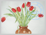 Red tulips in a brown pot