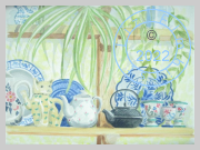 Teapots and plates on shelf